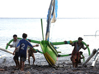 Pulling sailboat from Ocean Bali