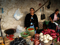 Woman selling vegetables Mexico