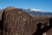 Petroglyph with mountains